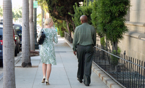 A man and woman walking at