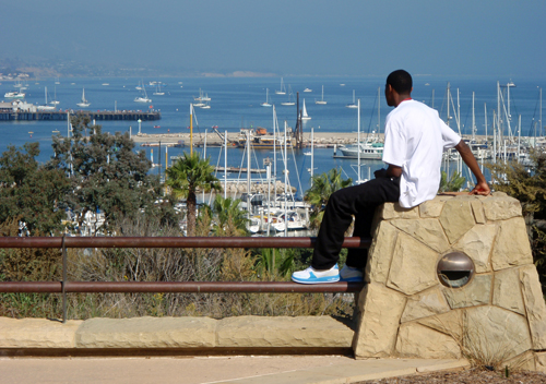 Young man admires the harbor from Winslow Maxwell Overlook