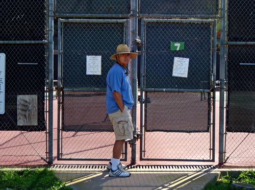 Tennis trainer outside SBCC tennis courts