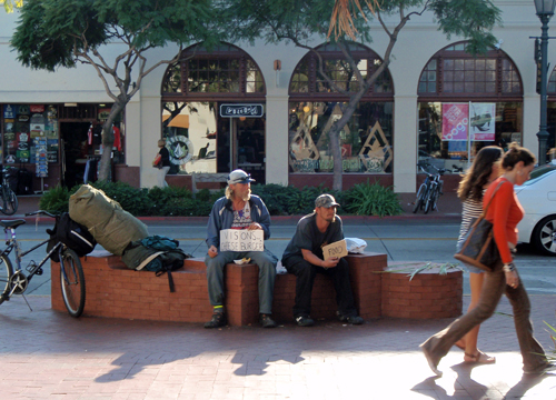 Homeless men begs for food in State Street